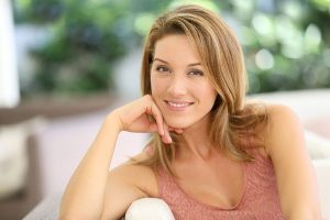 stock image of a female model smiling by holding hand