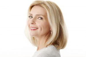 stock image of a female model smiling face
