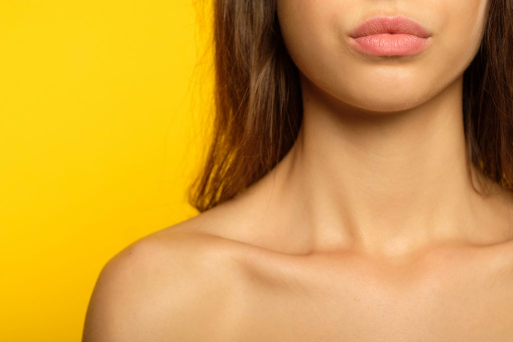 Woman with plump lips after facial fillers in Denver
